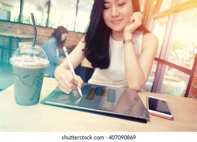 close up of a business woman analyzing business graphs on digital tablet