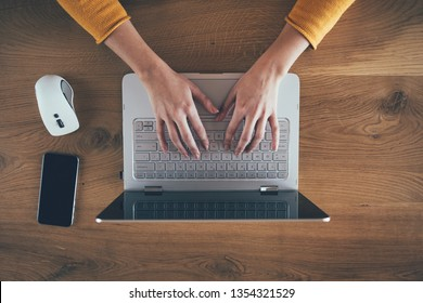 Close up of business woman hand working on laptop computer