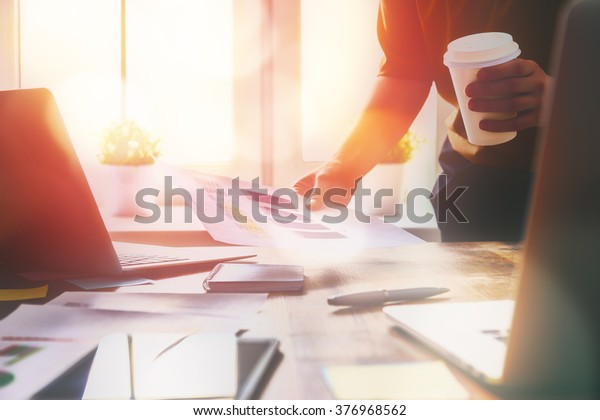 Close up business woman signing documents.