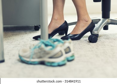Close up of a business woman sports shoes in an office