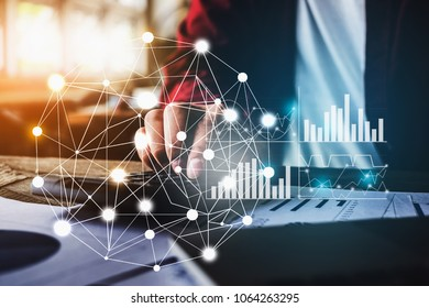 Close up Business woman using calculator and laptop for do math finance on wooden desk in office with financial network diagram, tax, accounting, statistics and analytic research concept