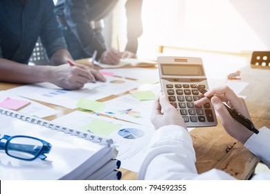 Close up Business woman using calculator for do math finance on wooden desk in office and business working background, tax, accounting, statistics and analytic research concept