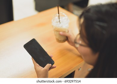 Close up business women hand holding mobile smart phone in the office.