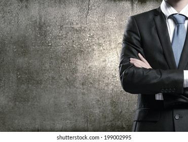 Close up of businessman with arms crossed on chest