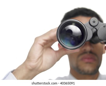 Close up of a businessman with binoculars isolated on white.