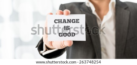 Close up Businessman in Business Suit Showing Small White Card with Change is Good Message.