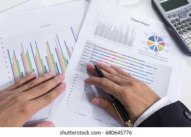 Close up Businessman check seriously analyzes a finance report investor colleagues discussing new plan financial graph. Finance managers task. Concept business and finance ,Account analyzes planing