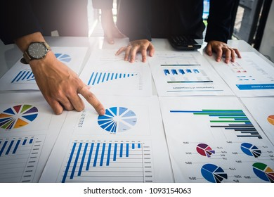 Close up Businessman consultant hand pointing at financial paperwork. finance, tax, accounting, statistics analytic research