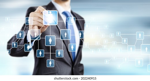 Close up of businessman drawing chain of interaction