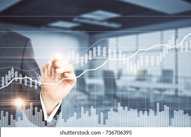 Close up of businessman hand drawing abstract forex chart on glowing blurry office interior background. Fund management concept. Double exposure
