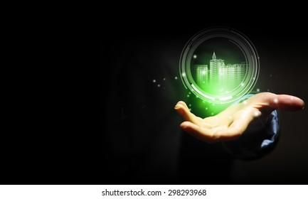 Close up of businessman hand holding digital construction model