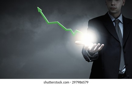 Close up of businessman hand holding increasing graph
