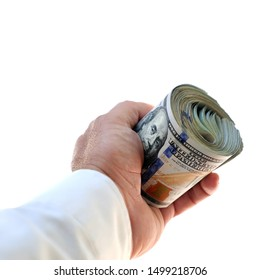 close up businessman hand holding rolled up American hundred dollars pile over white background