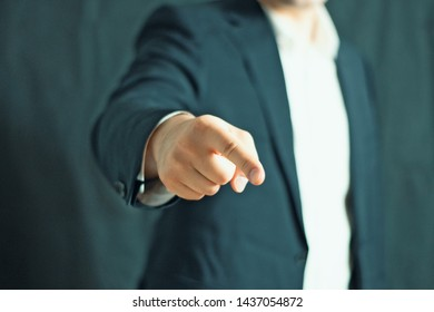 Close up of a businessman hand pointing at camera