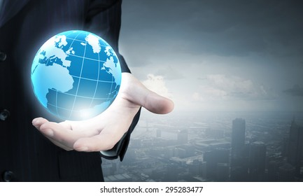 Close up of businessman hand showing digital earth globe