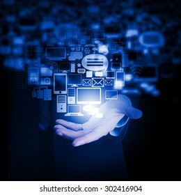 Close up of businessman hand showing digital icons