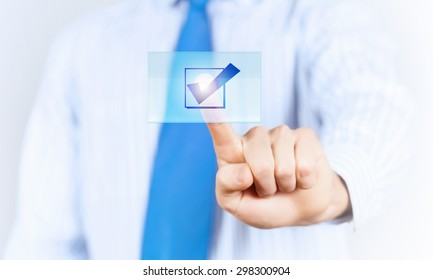 Close up of businessman hand touching icon with finger