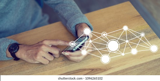close up businessman hand touching on smartphone screen with networking connect effect for technology concept