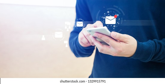 close up businessman hand touchscreen on smartphone devices for received unread e-mail listing or sending mail to partner and customer , virtual interface technology concept