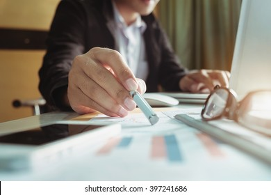 close up of businessman hand working with new modern computer and graph business with social network diagram and man working