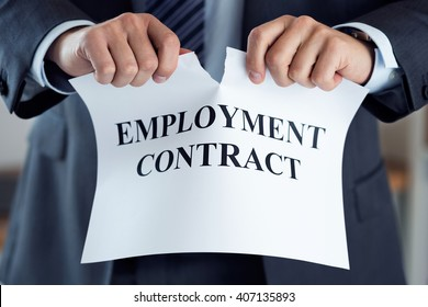 Close up of businessman hands breaking employment contract. Boss dismissing an employee. Bankruptcy, redundancy and getting fired concept. Employee loosing job or failing interview. Human resources
