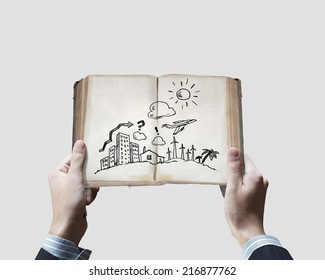 Close up of businessman hands holding opened book with sketches