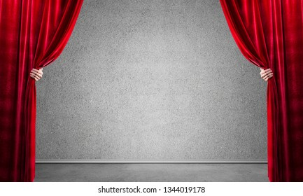 Close up of businessman hands open red velvet curtain. Place your text