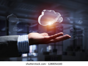 Close of businessman hands showing glass cloud computing concept. Mixed media