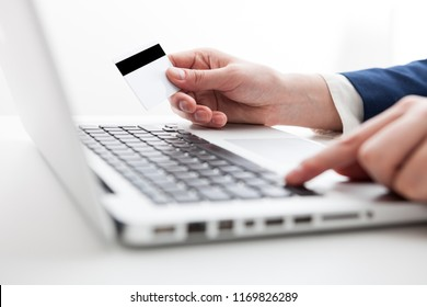 Close Up of businessman hands using laptop computer with blank copy space screen for your advertising text message or content business