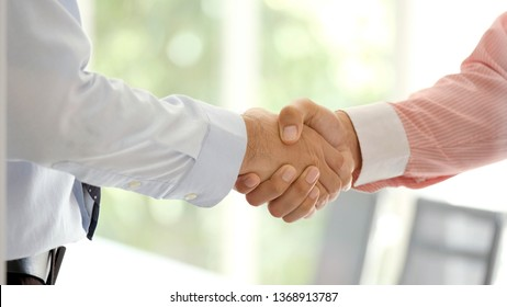 Close up of businessman handshake at office, business cooperation, success in business concept