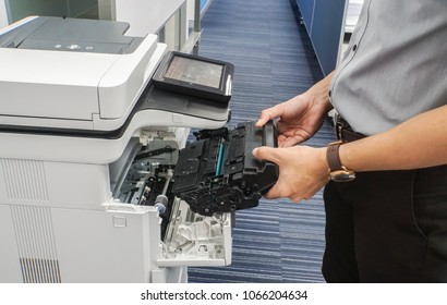 close up businessman hold toner cartridge to put into printer feed