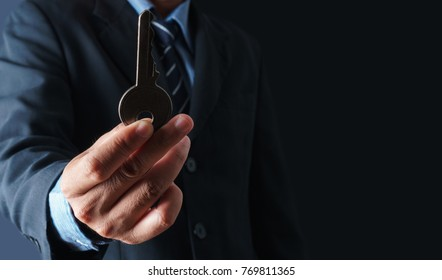 Close up of businessman holding the key to success concept