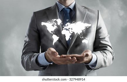 Close up of businessman holding world map in hands