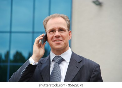 Close up of a businessman making a phonecall outside