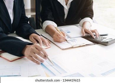 Close up Businessman and partner using calculator and laptop for calculating finance, tax, accounting, statistics and analytic research concept