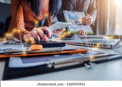 Close up Businessman and partner using calculator and laptop for calculation finance, tax, accounting, statistics and analytic research concept. in the office.