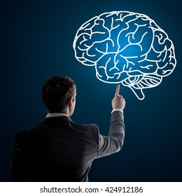 Close up of businessman pointing at brain on digital screen