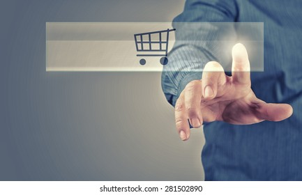Close up of businessman pushing shopping cart icon