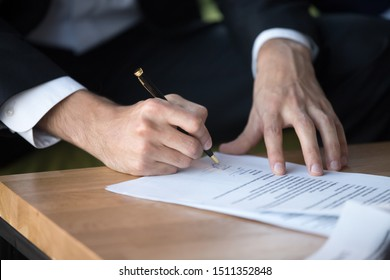 Close up businessman signing contract, partnership agreement after successful negotiation, making legal deal, putting signature, hiring process, candidate filling job agreement, good deal