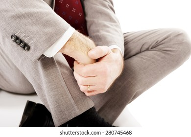 Close up businessman sitting on the floor.