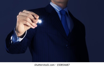 Close up of businessman sketching business project