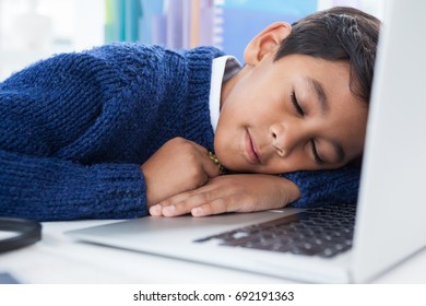 Close up of businessman sleeping on laptop at desk in officce