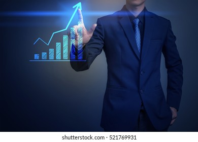 Close up of businessman touching finance graph with finger