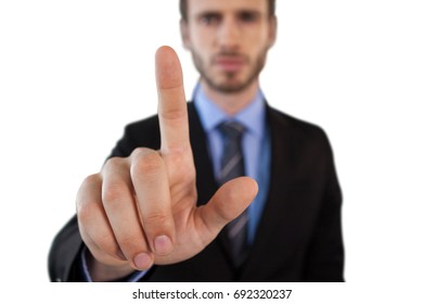Close up of businessman touching on invisible interface against white background