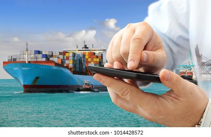 Close up of businessman using smart phone for logistic business on cargo ship background
