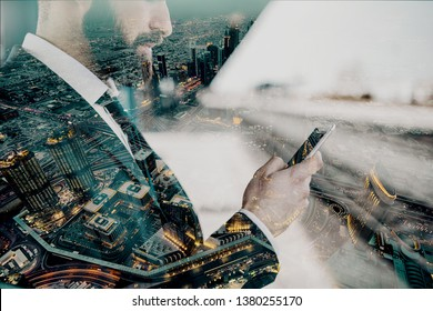 Close up of businessman using smart phone and waiting for train to come. Business trip concept. Double exposure technique used.