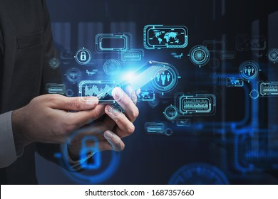 Close up of businessman using smartphone in blurry office with double exposure of futuristic infographics interface. Concept of hi tech and big data. Toned image
