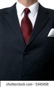 Close up of a businessman wearing a blue suit, white shirt and red star tie.