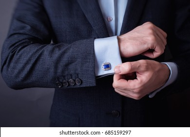 Close up of businessman wearing cufflinks.