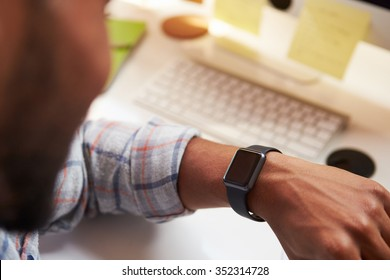 Close Up Of Businessman Wearing Smart Watch In Design Office